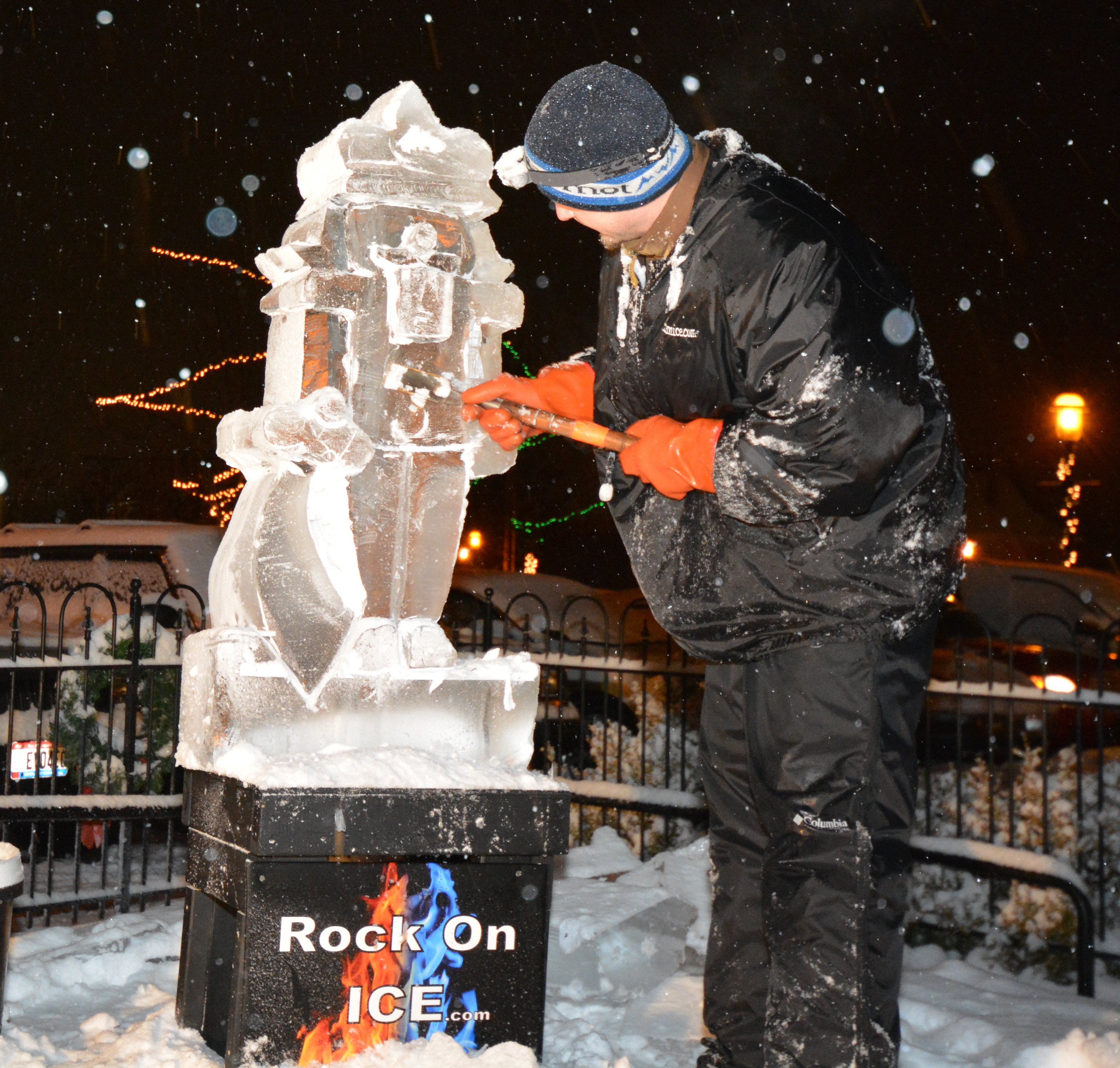 Man Carving Ice Sculpture